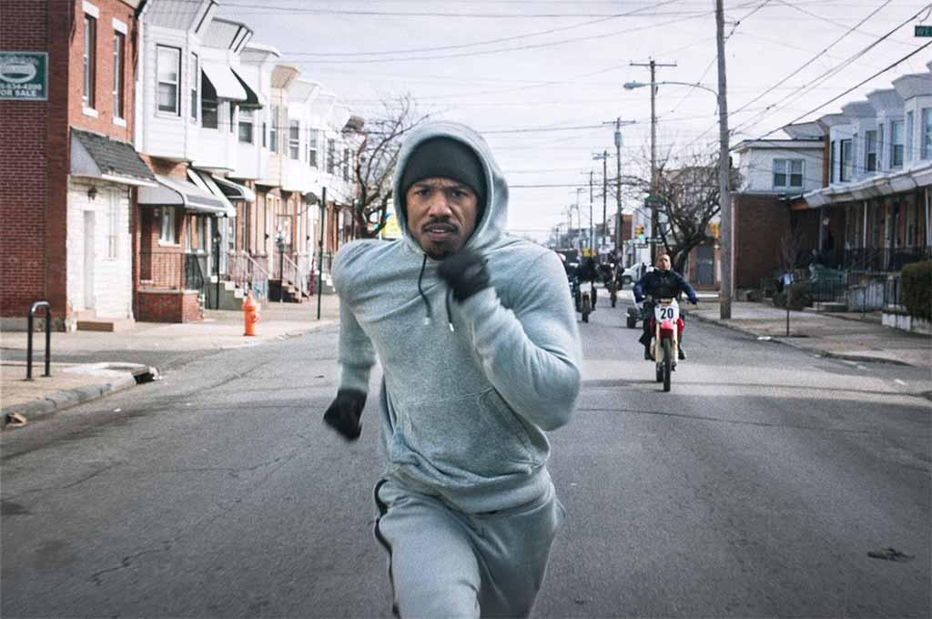 Michael B. Jordan running through the streets of Philadelphia